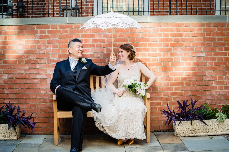 bride and groom umbrella shoot