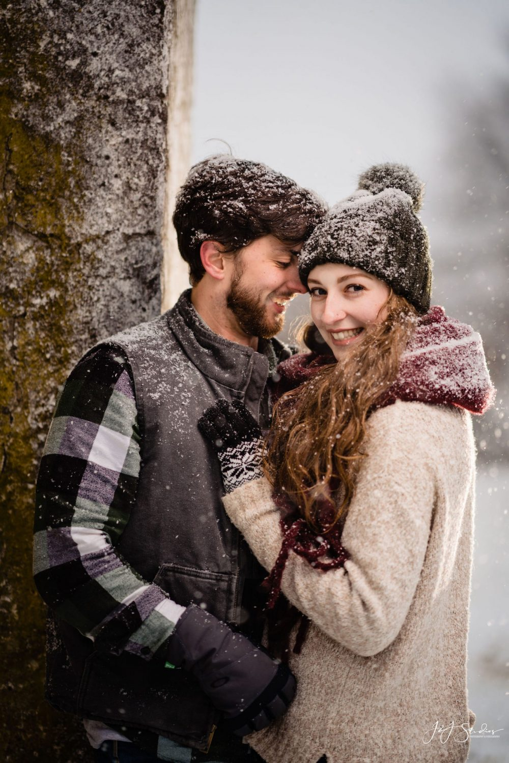 couple cuddle in snow