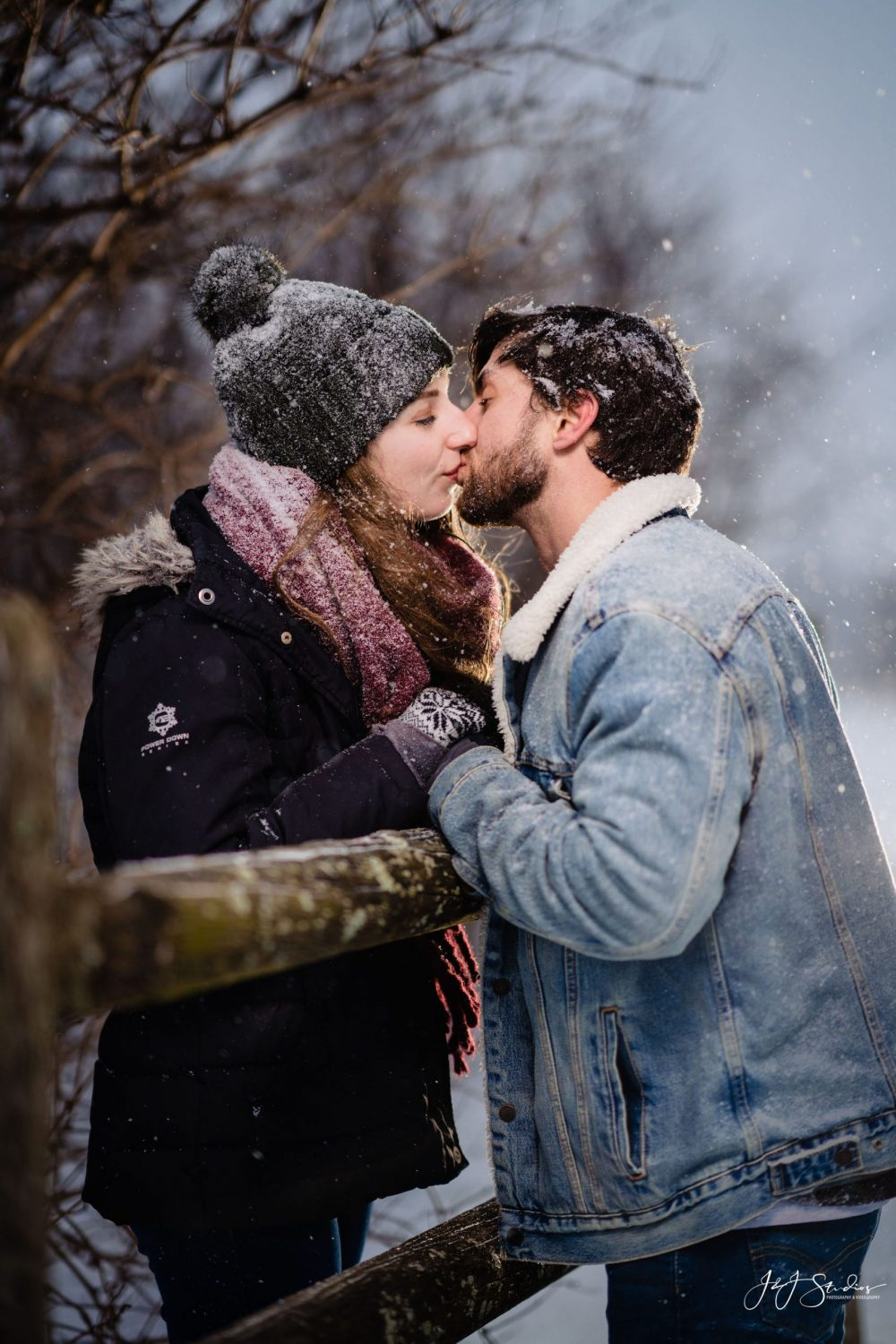 engagement photography fence snow