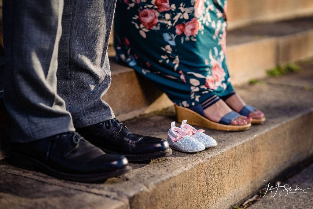 couple and baby shoes