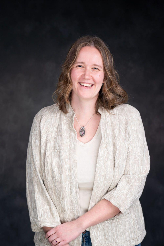 Smiling woman in cream sweater Fort Washington Headshot Corporate Photographer