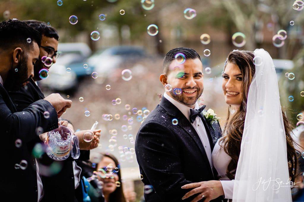 happy couple bubble exit wedding