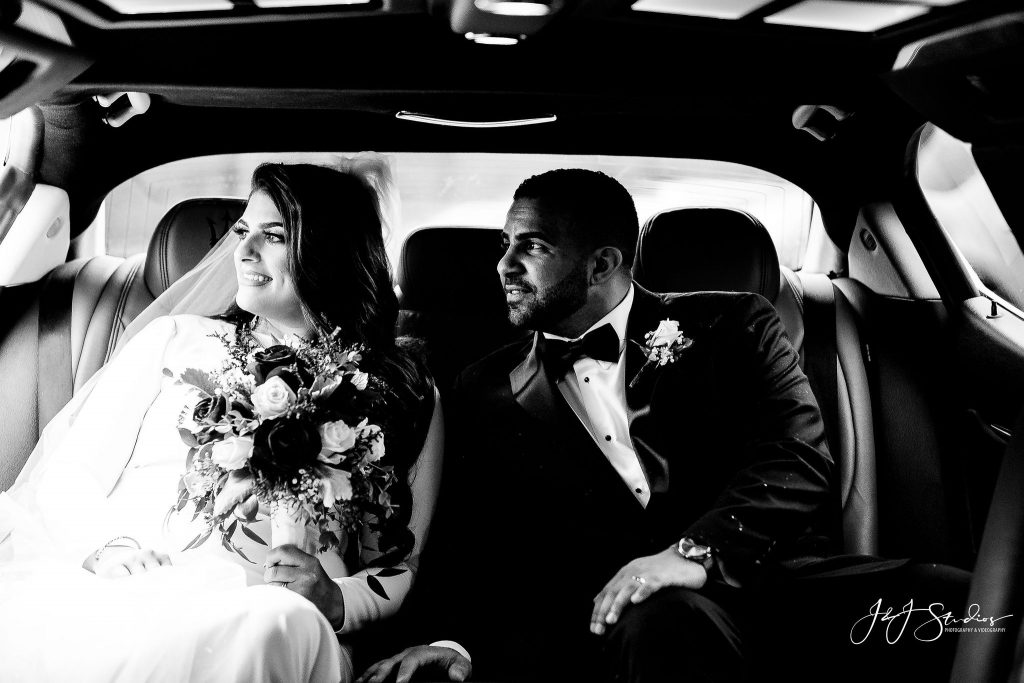 newlyweds in car black and white
