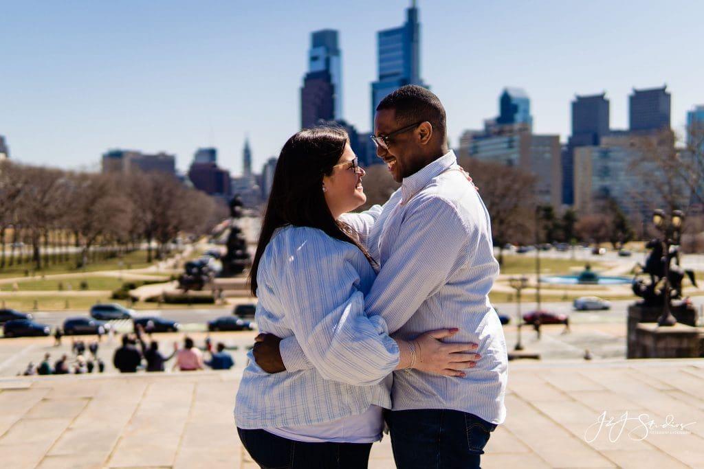 engaged couple philadelphia hug