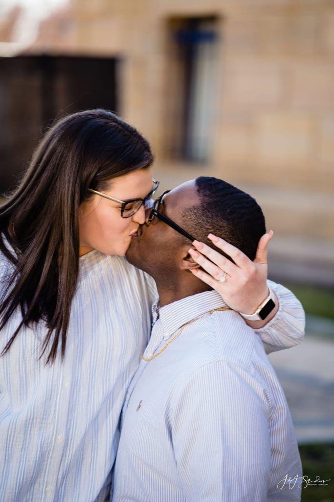 woman kissing fiance