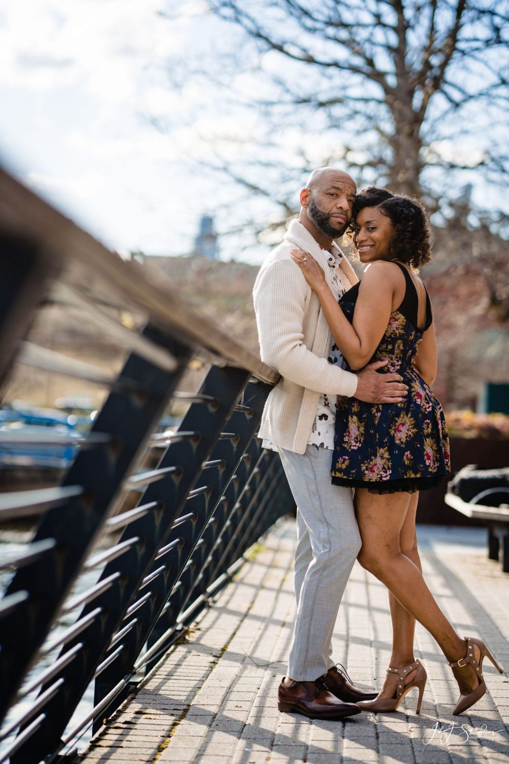 Couple embracing Downtown Philly Engagement