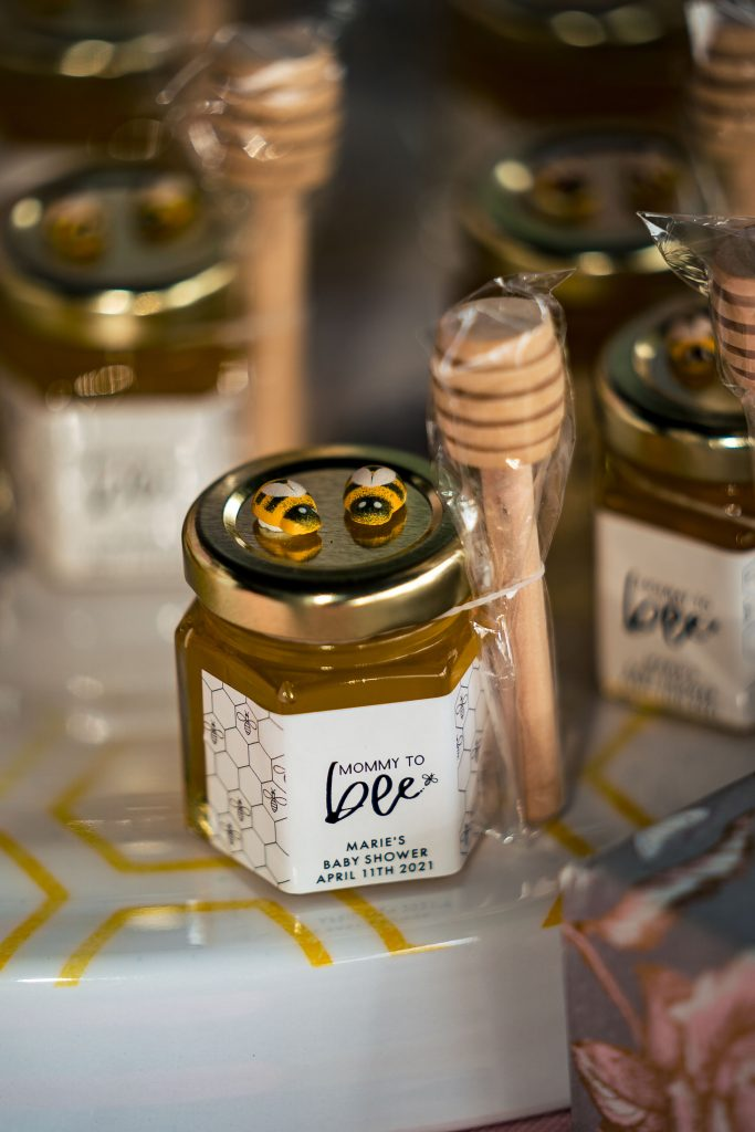 honey with dipper and bees