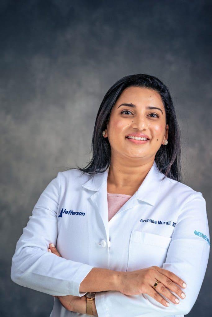 confident professional headshot of female doctor