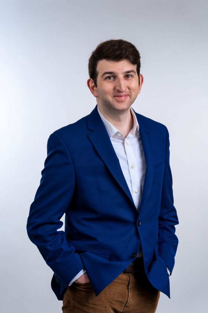 professional headshot phtography of man with hands in pockets