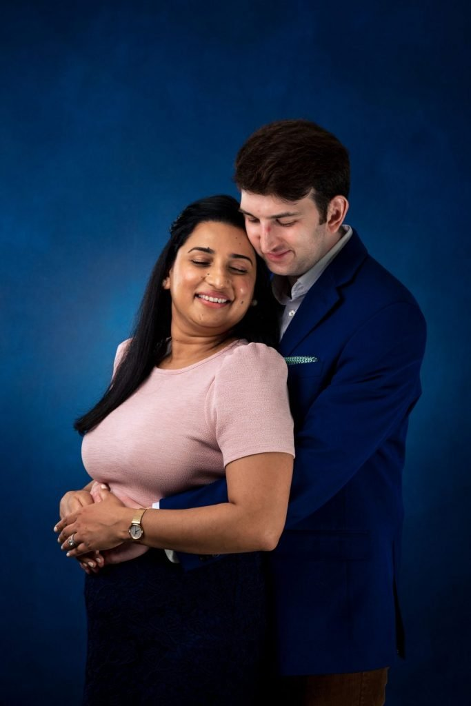 professional couple man holding woman from behind