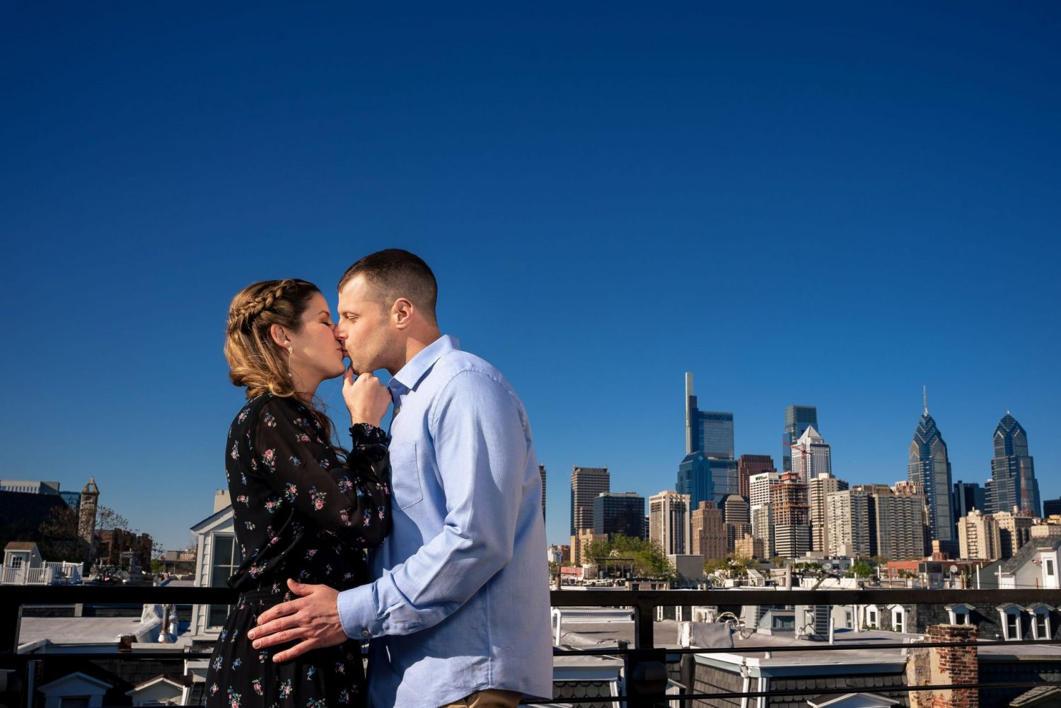 engaged couple embracing Philly engagement session