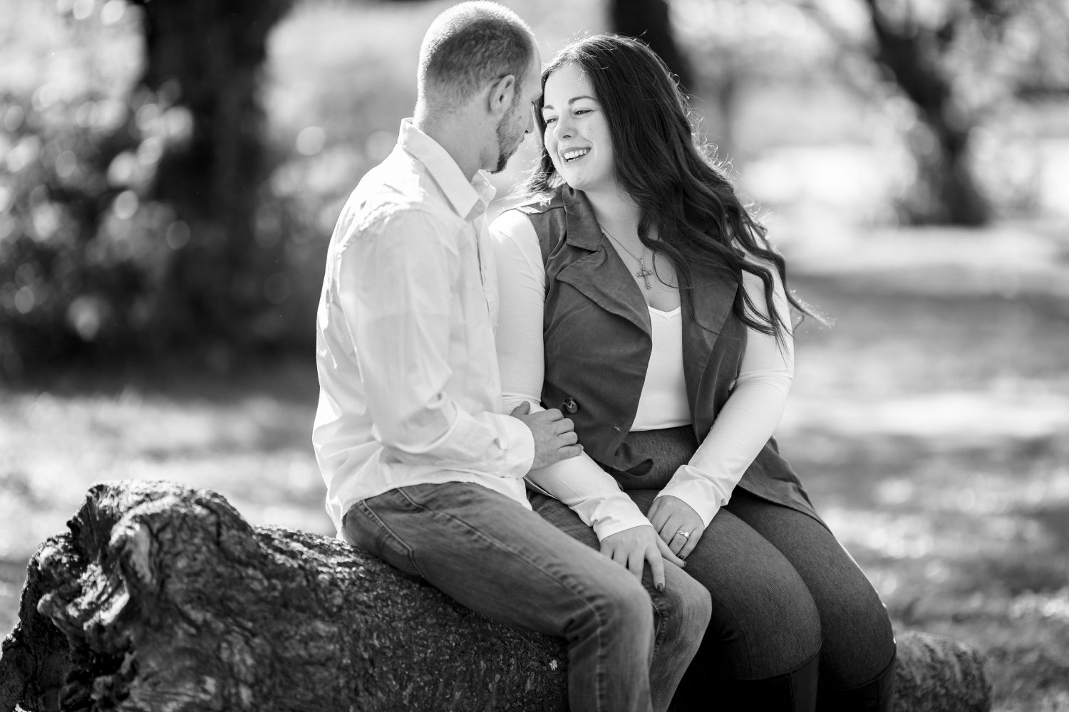 Black and white photo of couple talkig Kelly Drive Cherry Blossom Engagement Session
