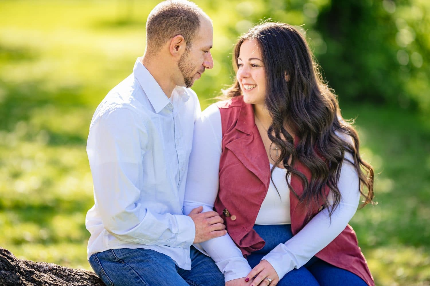 Couple smiling and laughing in park
