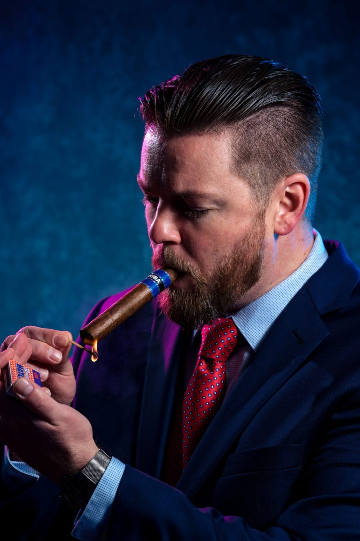 Groom lighting the cigar