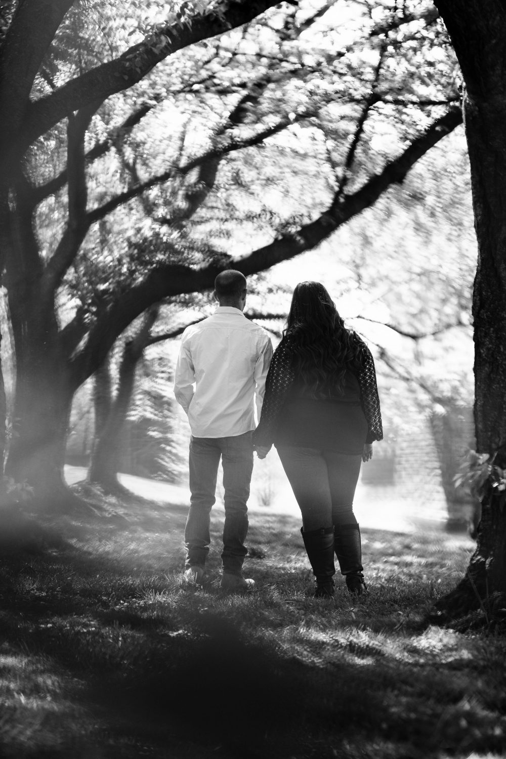 black and white photo of couple hand in hand Kelly Drive Cherry Blossom Engagement Session