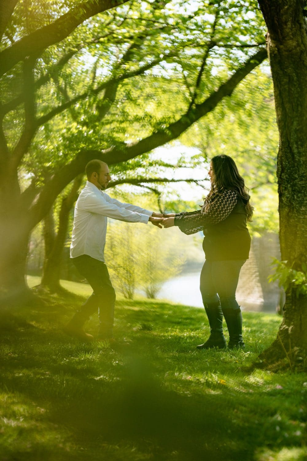 Stephen and Victoria holding hands Kelly Drive Cherry Blossom Engagement Session