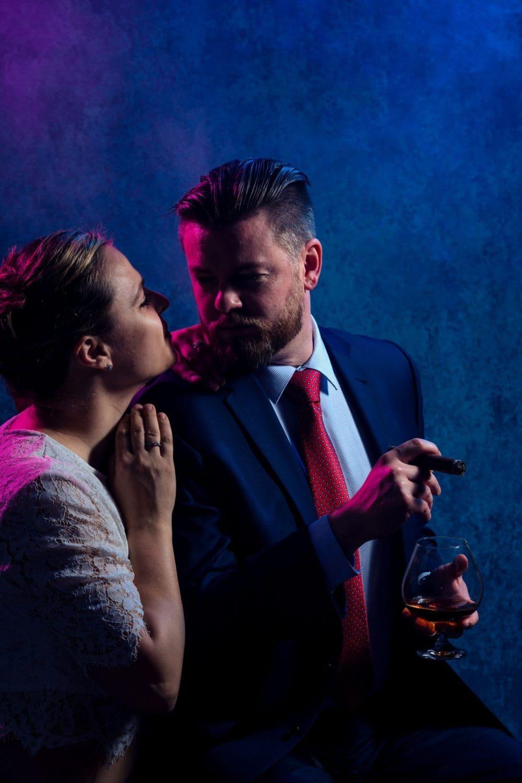 Woman looking into man's eyes Groom Cigar And Shots