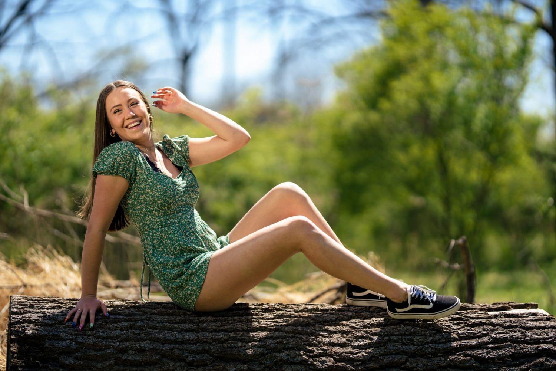 Girl posing on tree stump Senior Photography Philadelphia