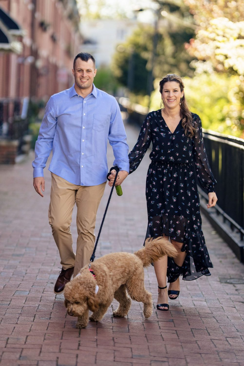 Couple walking their dog Philly engagement session