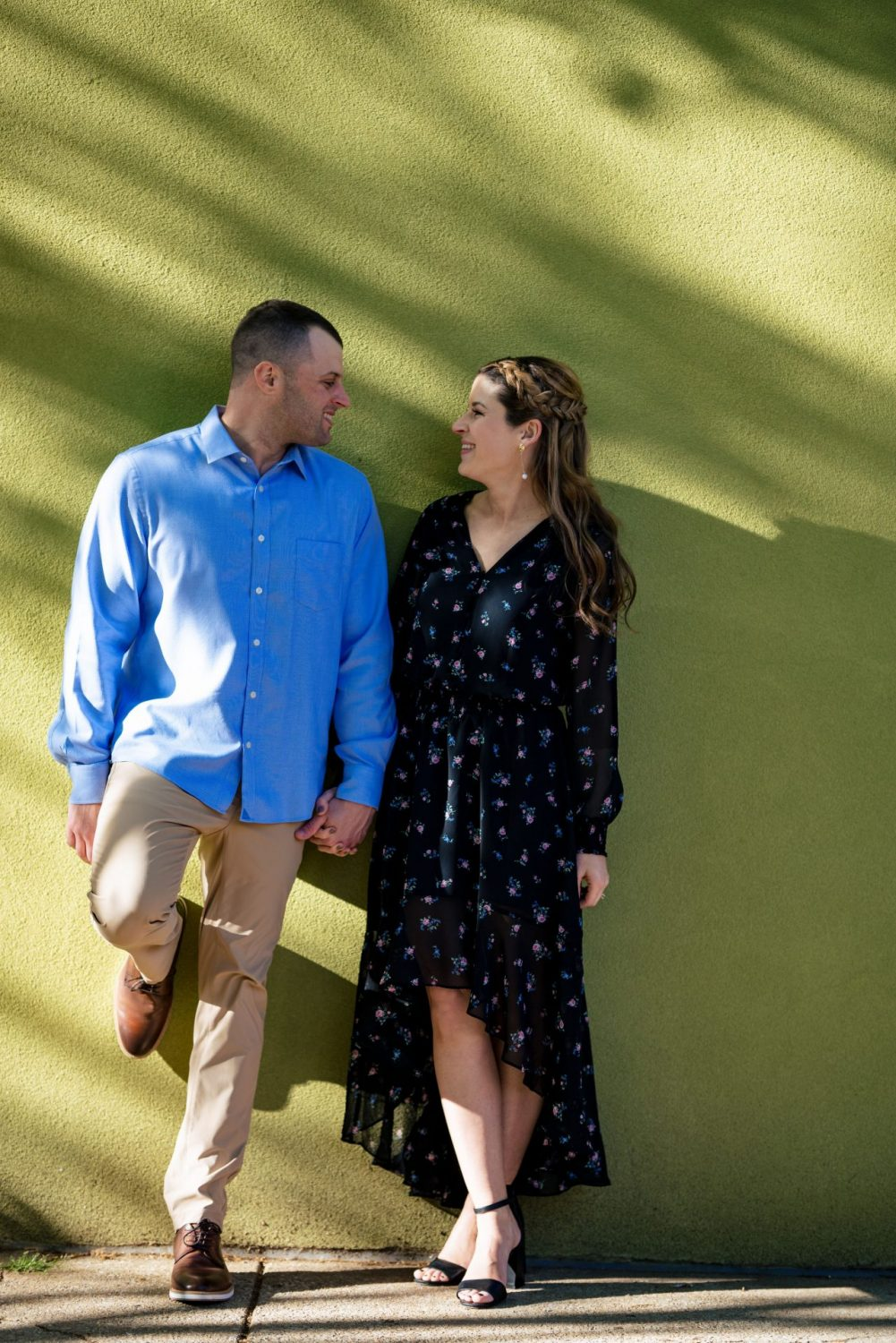 Couple against green backdrop Philly engagement session