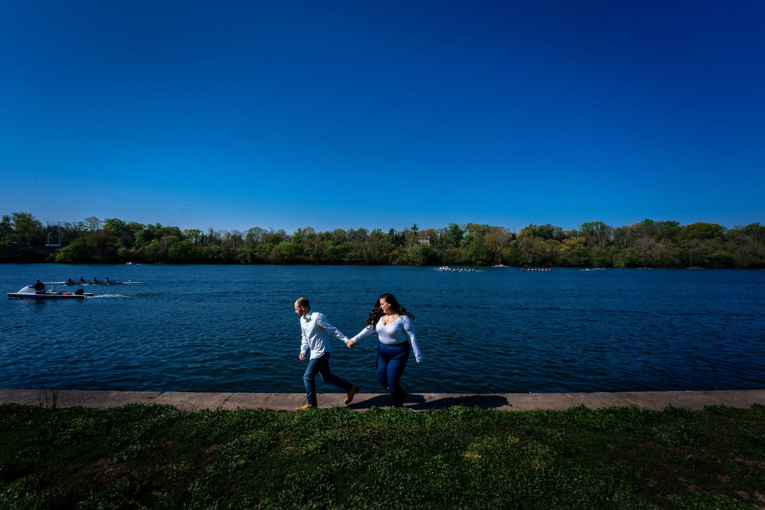 Couple walking near the pond
