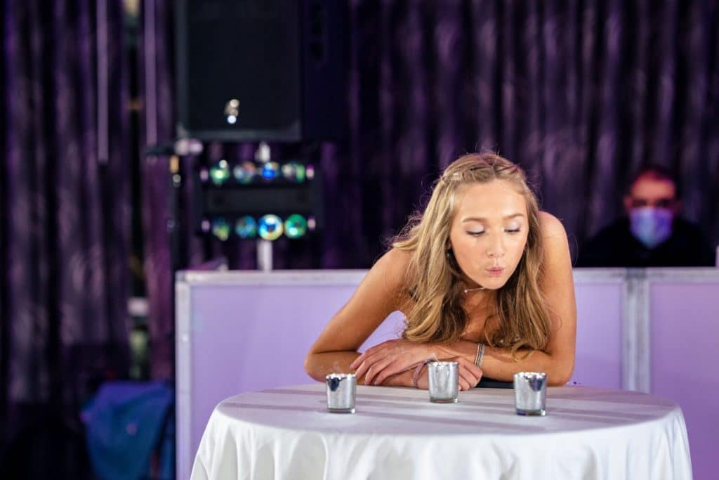 bat mitzvah girl blowing out candles