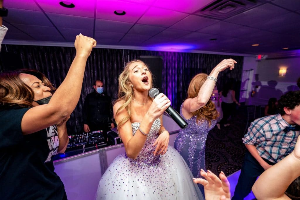 bat mitzvah girl singing into microphone