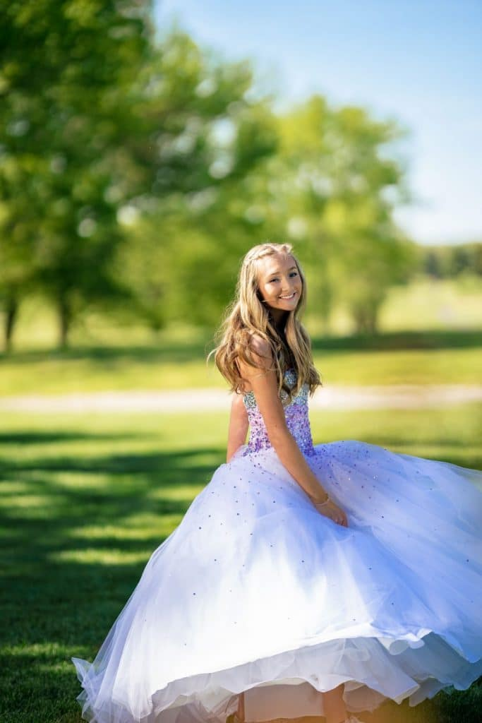 bat mitzvah girl twirling in ball gown