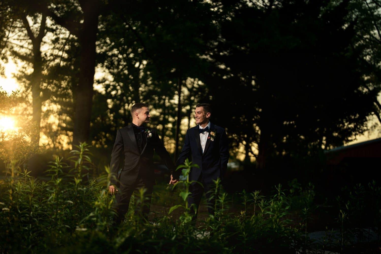 Grooms in love on farmhouse property Bishop Farmstead Wedding shot by John Ryan