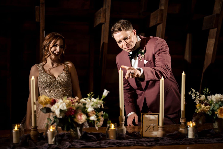 Groom lighting the candle during reception Bishop Farmstead Wedding shot by John Ryan