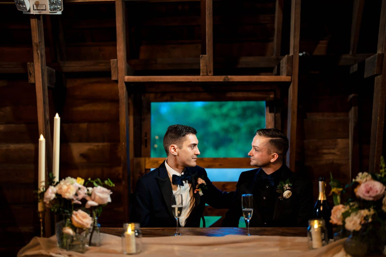 Sean and Dana sitting during reception Bishop Farmstead Wedding shot by John Ryan
