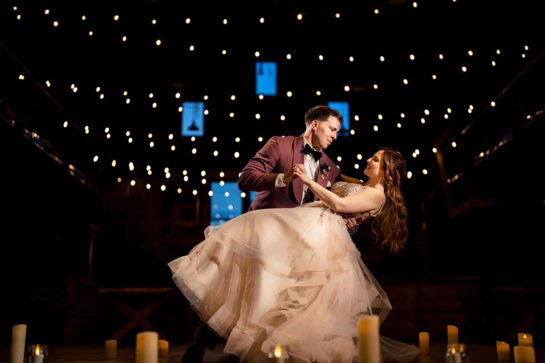 Groom dips bride during reception in South hampton at Bishop Farmstead Wedding shot by John Ryan