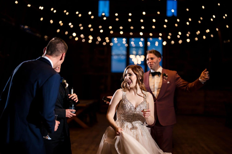 Weddin gparty dancing at reception Bishop Farmstead Wedding shot by John Ryan