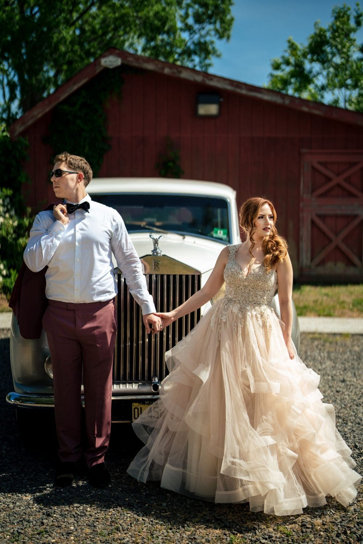 Bride and groom hand in hand vintage rolls royce shot by John Ryan
