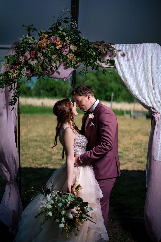 Jon kissing his beautiful bride at a farmhouse wedding in Southhampton New Jersey