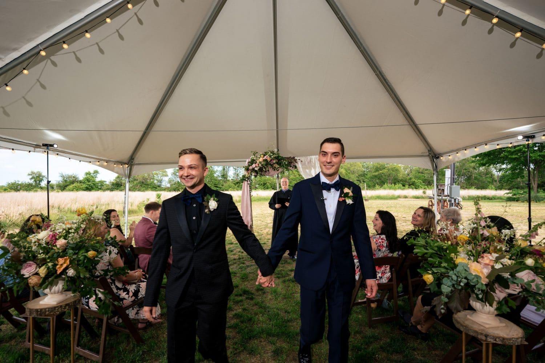 beautiful engaged couple holding hands Bishop Farmstead Wedding shot by John Ryan