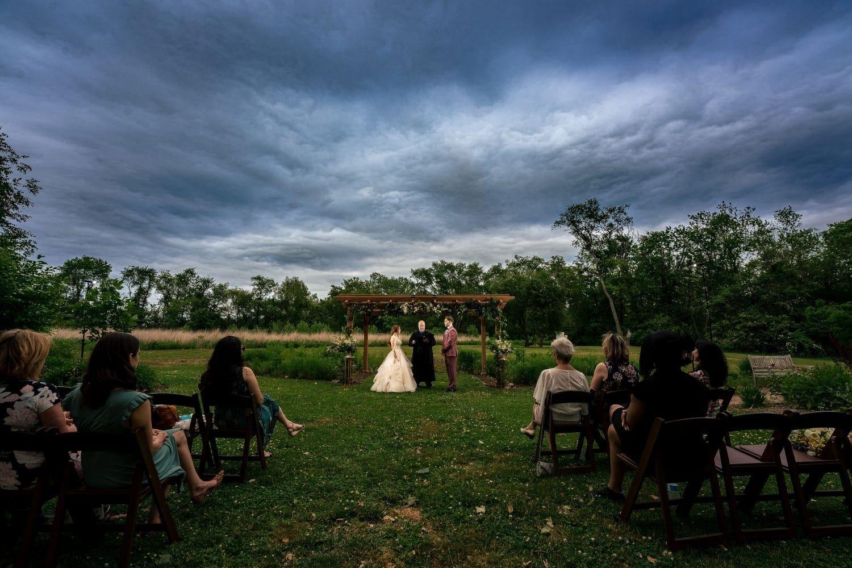 Gianna and Jon outdoor vows Bishop Farmstead Wedding shot by John Ryan