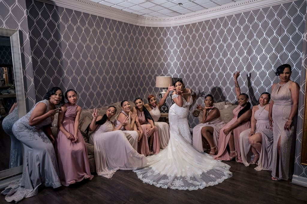 Bride and her bridesmaids ready by J&J Studios