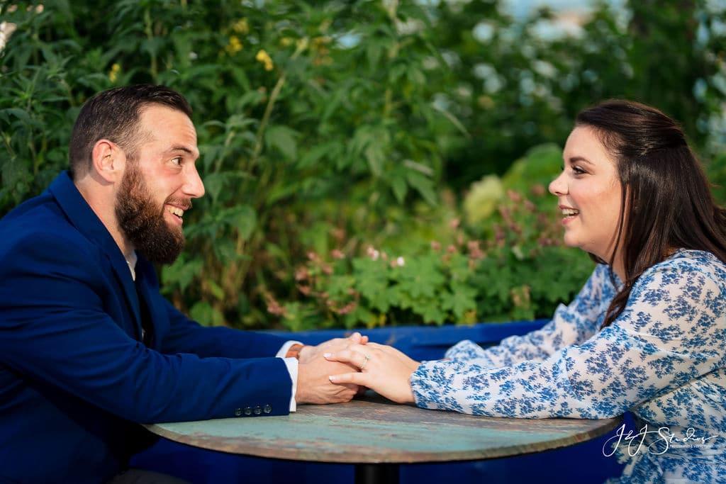Couple chatting by J&J Studios
