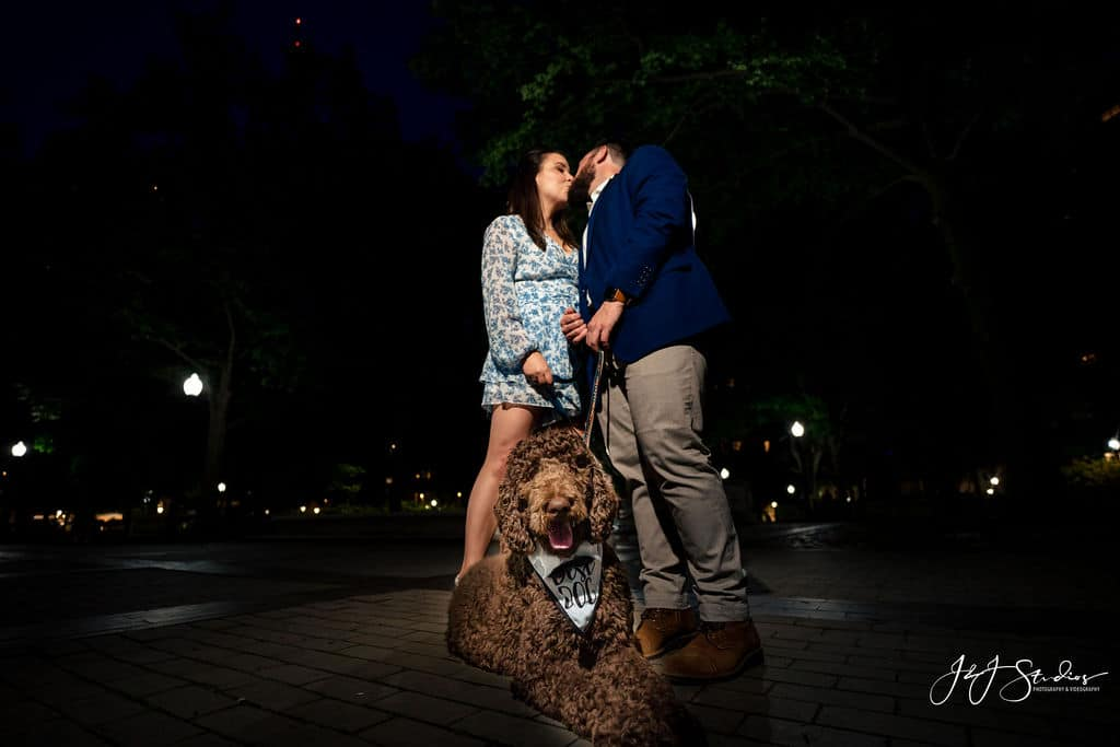 Couple and their dog by J&J Studios