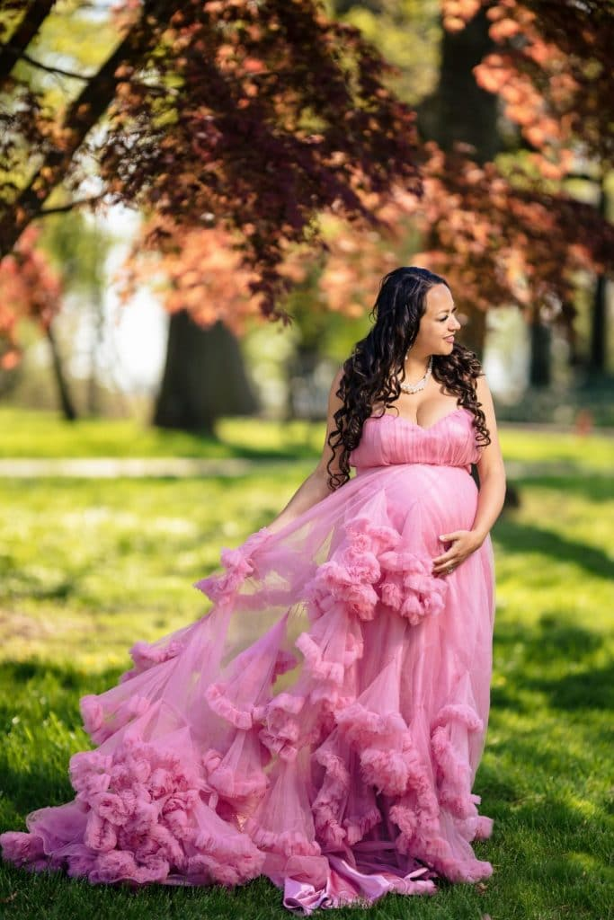 woman in pink dress with layers in a park