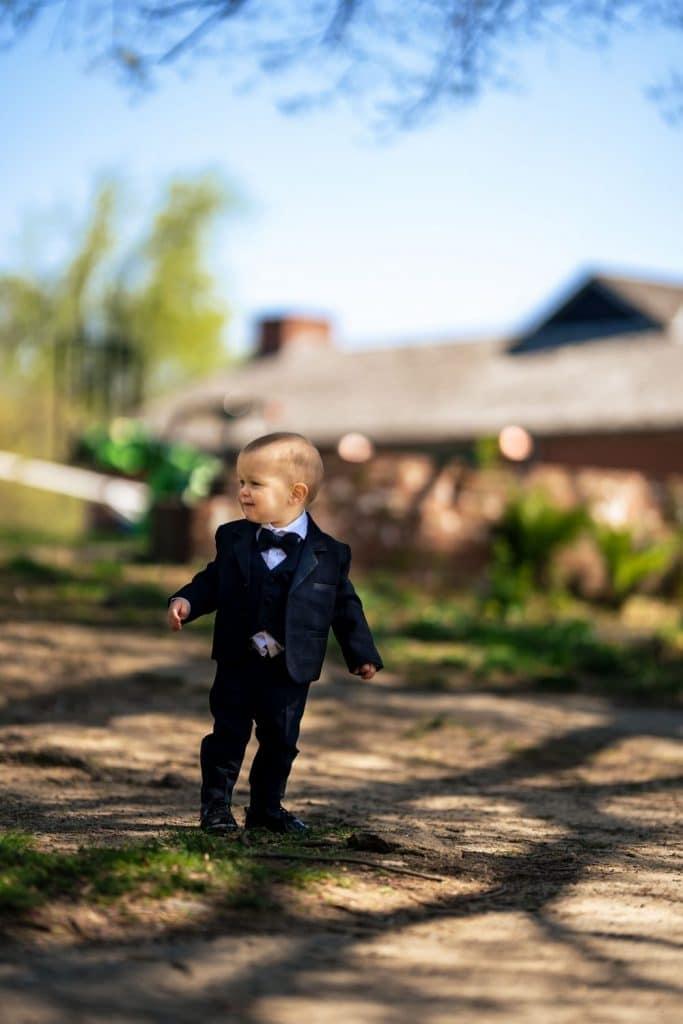 baby boy in suit walking