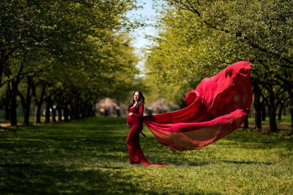 woman in red dress maternity spring photography