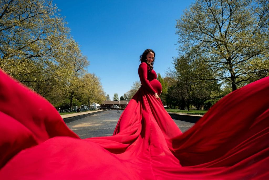 woman with red billowing train on dress