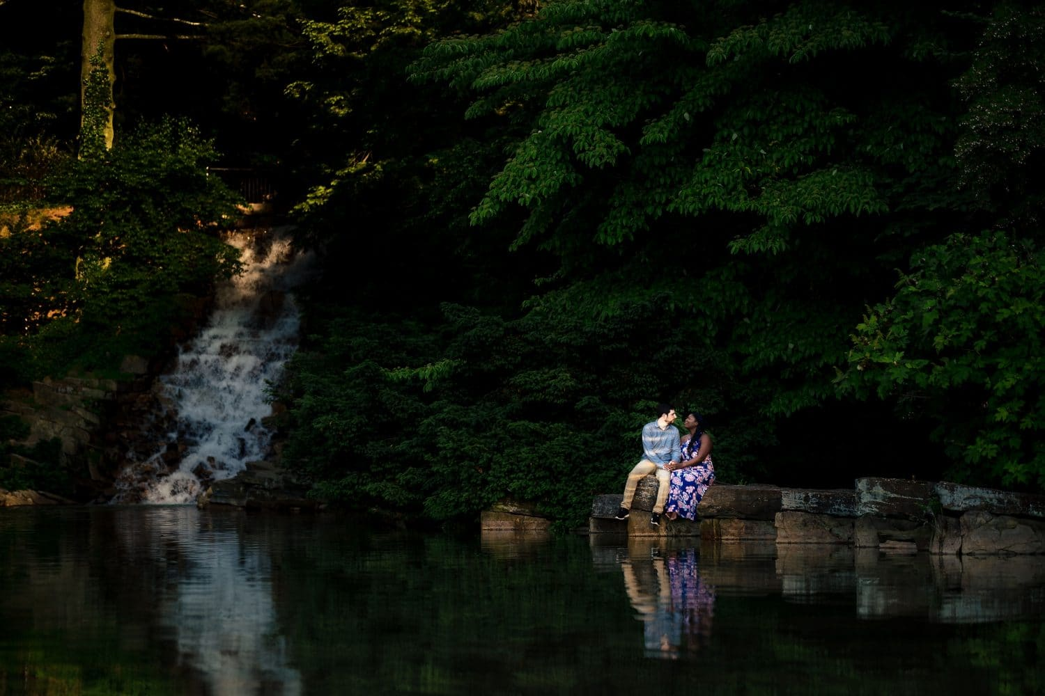 Couple by the waterfall Longwood Gardens Engagement Shot By John Ryan