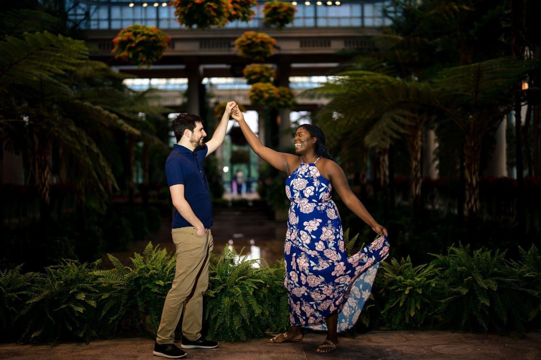 Couple dancing in garden in Longwood Gardens Engagement Shot By John Ryan