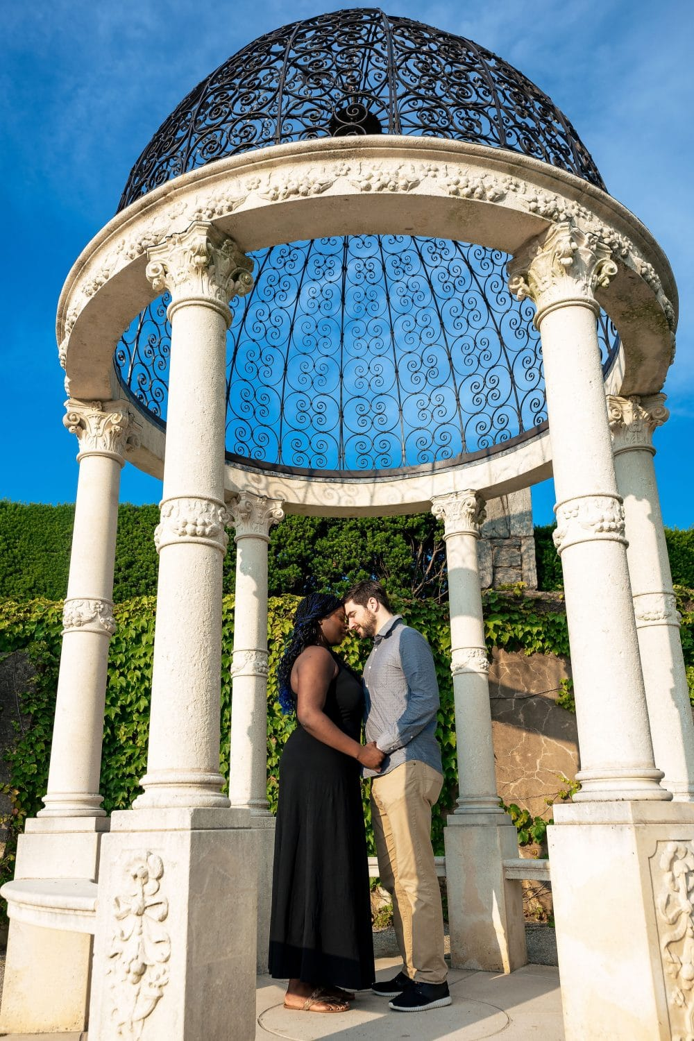 Couple embracing sunny afternoon Longwood Gardens Engagement Shot By John Ryan