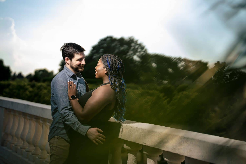 Balcony embrace between couple in love