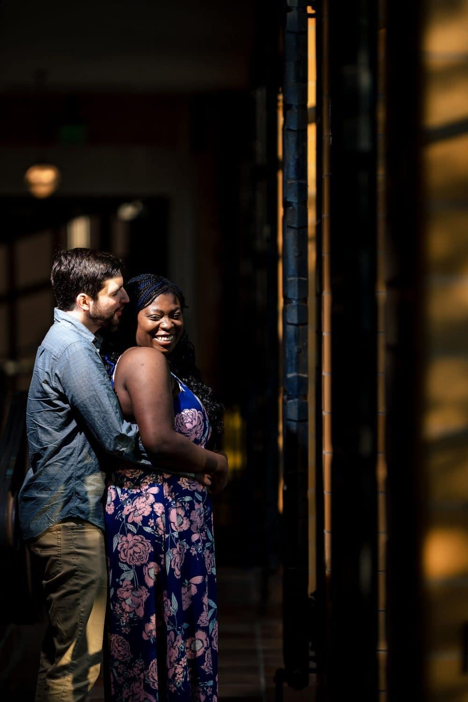 Corey embracing Dinah at Longwood Gardens Engagement Shot By John Ryan