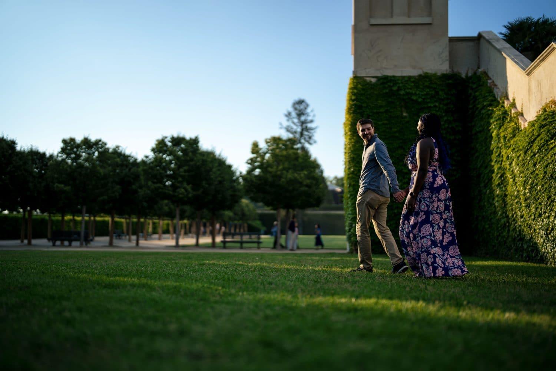 Couple hand in hand strolling Longwood Gardens Engagement Shot By John Ryan